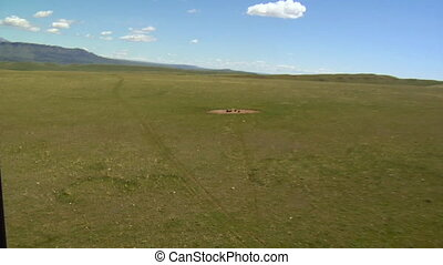 Aerial shot of antelope at cattle water trough
