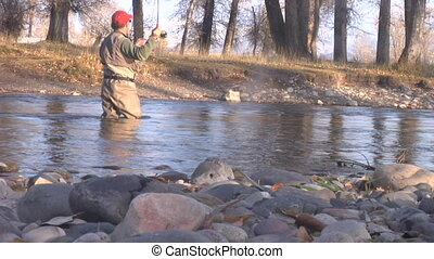 fly fisherman casts intensely in stream