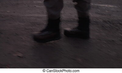 fly fishermen in boots walking on dirt road