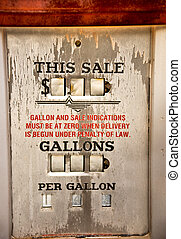 Gasoline? Priceless. - Weathered sign on a vintage gas pump,...