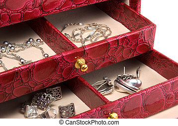 Casket with jewelry - The red casket with jewelry is...