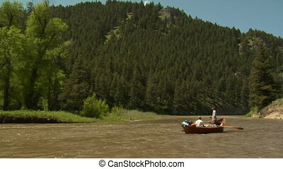Driftboat in River with mountains 2
