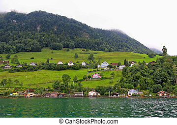 The small village on the hills around Lake Luzern in...
