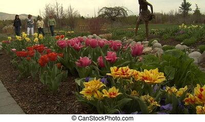 ladies admire tulips in Park