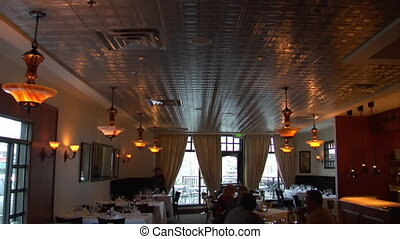 large restaurant dining room with warm lighting