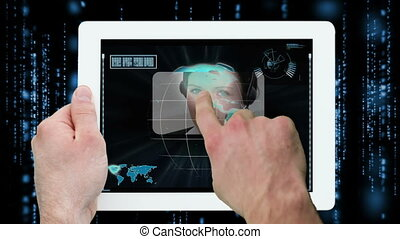 Hands using digital tablet displaying call centre workers on...
