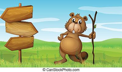A beaver holding a wood beside a wooden signboard -...