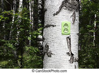power receptacle on a tree - ecological concept, symbolizing...