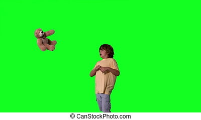 Little boy jumping up and kicking t