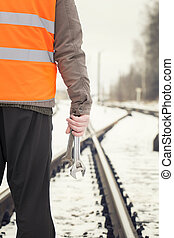 Worker on railway crossings - Worker with adjustable wrench...
