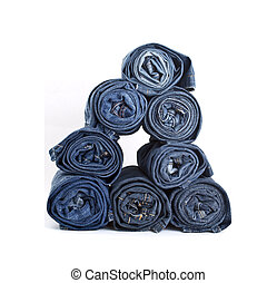 Jeans trousers stack - roll blue denim jeans arranged in...