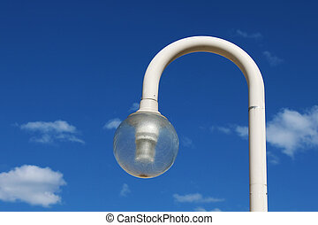 Streetlight against a blue sky.