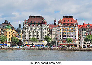 Stockholm . Beautiful buildings on the quay against the...
