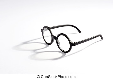 Vintage spectacles with round lenses on a white background...