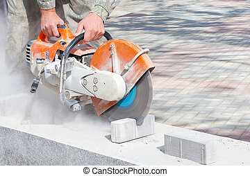 Cutting concrete paving stabs - Cutting and grinding...