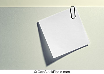 Blank memo attached to a document - Small white blank...