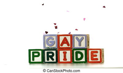 Confetti falling on blocks spelling gay pride in slow motion