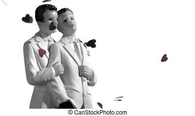 Confetti falling on gay groom cake toppers in black and...