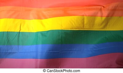 Rainbow flag blowing in the breeze in slow motion