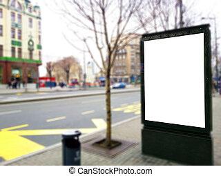 Empty billboard at bus stop
