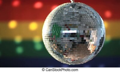 Disco ball revolving against gay pride flag video