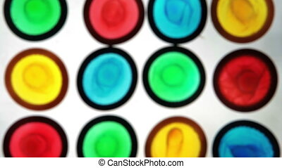 Colourful condoms on white surface