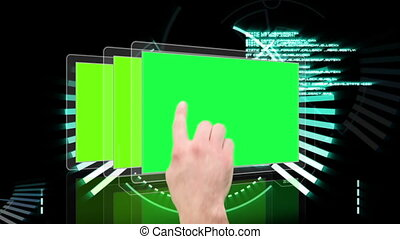 Hand scrolling through futuristic interface with green copy...