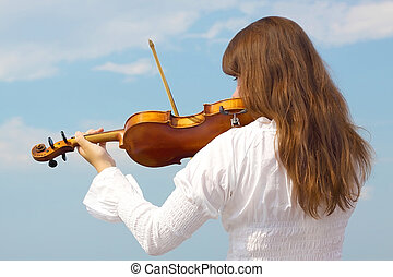 Girl with violin - Young woman playing violin on sky...