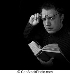 man with glassess reading book