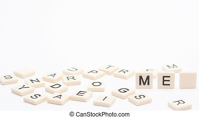 Autism and asperger spelled out in plastic letter pieces in...
