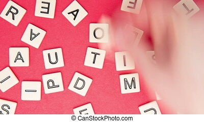 Autism spelled out in letter pieces in stop motion