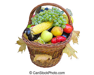 Wicker basket with autumn fruit and vegetables isolated over...