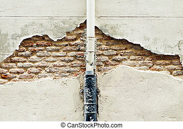 Detail of Old Brick Wall with paint pipe