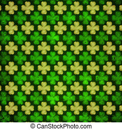 striped shamrocks in green old paper background out of focus