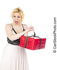 woman unwrapping present - Woman wearing a white dress and...