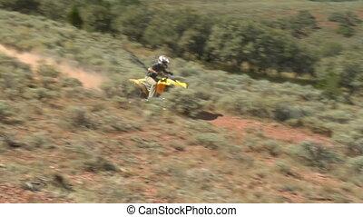 single ATV rider speeds by camera