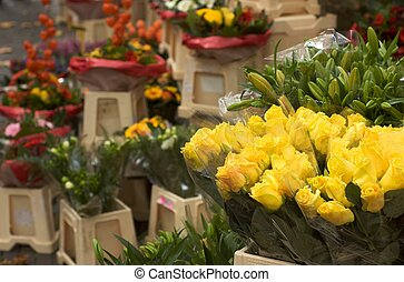 Flower stand on a flower market in Holland with yellow roses...