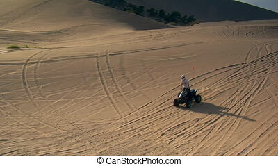 ATV rider climbs Sand Dune in slow motion