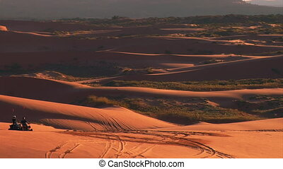 wide vistas of desert and two ATV riders