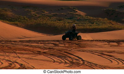 2 ATV riders on red sand