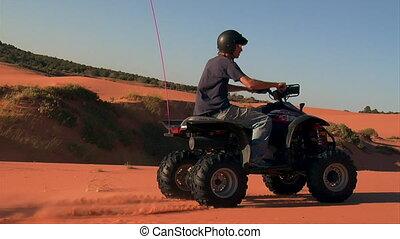 fast high shutter speed ATV rider