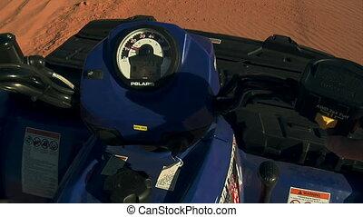 POV ATV riding on sand dunes