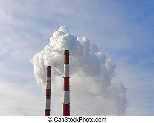 Two chimneys pollution air - Two dirty red and white smoking...