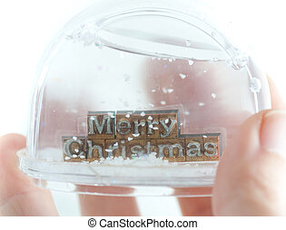 Snowglobe - The phrase Merry Christmas in snowglobe on white...