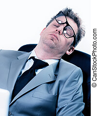 tired funny businessman at the office - tired funny portrait...
