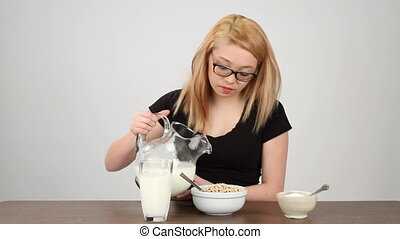 Breakfast No Sugar - Teenage girl pours milk on her...