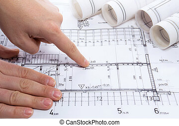 Architect drawing rolls and plans blueprints project