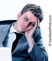 exhausted businessman at the office - Portrait of exhausted...