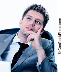 portrait of businessman dreaming or thinking at work -...