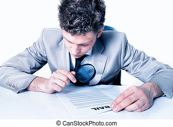 Businessman with magnifying glass analyze contract